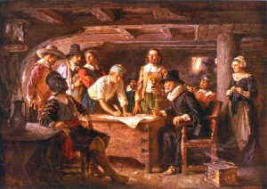 "The Pilgrims drafted ""The Mayflower Compact"" combining themselves into a ""civil body politic to enact equal and just laws to serve the common good"" in the cabin of the Mayflower before landing."